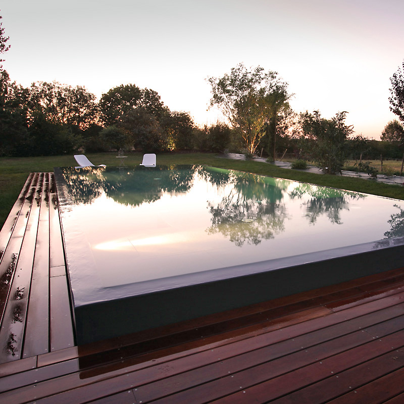 Construction d 39 une piscine miroir mobilier d coration for Construction piscine miroir